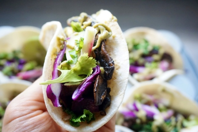 Smokey portobello, sweet potato & kale tacos + roasted chile avocado crema